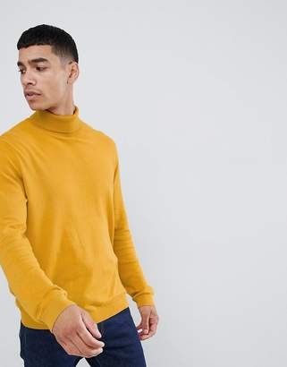 Asos DESIGN cotton roll neck sweater in mustard