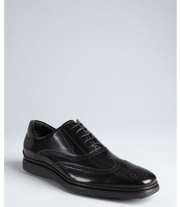 Tod's black patent leather wingtip oxfords