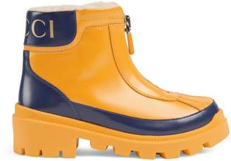 Gucci Children's leather boot with faux fur lining