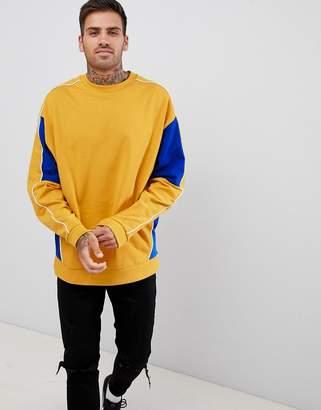 Asos Design DESIGN oversized sweatshirt with colour blocking