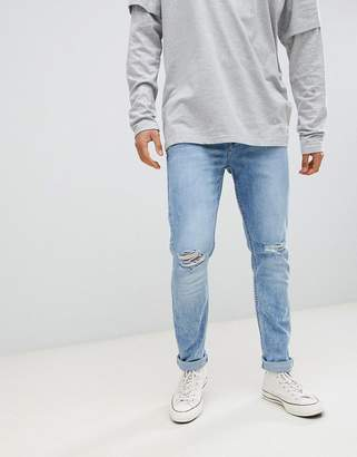 Antioch Stretch Ripped Skinny Jeans in Light Blue Stone Wash