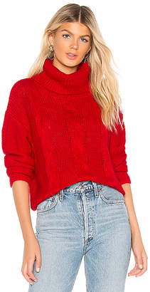 About Us Jeanine Cable Knit Sweater
