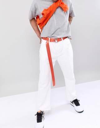 Asos DESIGN slim woven long ended belt in orange with d-ring fastening