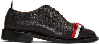 Thom Browne Black Wholecut Bow Oxfords $1,050 thestylecure.com