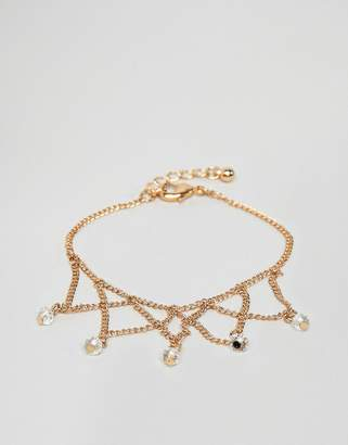 Asos DESIGN chain bracelet with draping chain design in gold