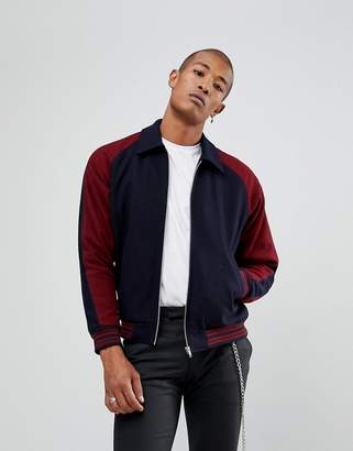 Asos DESIGN varsity jacket in burgundy
