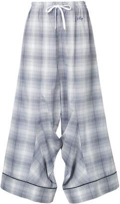 Facetasm plaid flared trousers