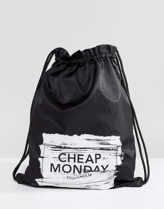 Cheap Monday Paint Brush Logo Drawstring Bag