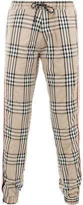Andrea Crews check tapered trousers