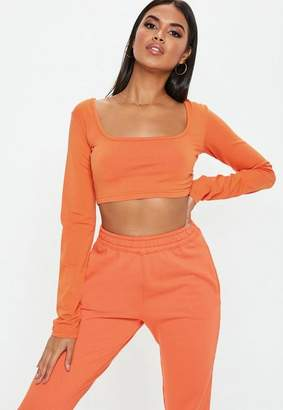 46a7a4f24cd77 at Missguided · Missguided Orange Long Sleeve Scoop Neck Crop Top