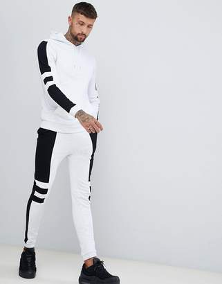 Asos DESIGN tracksuit hoodie/super skinny joggers with panels in white marl and black