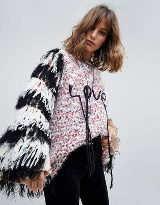 Native Rose oversized flecked sweater with fringed sleeves and love slogan