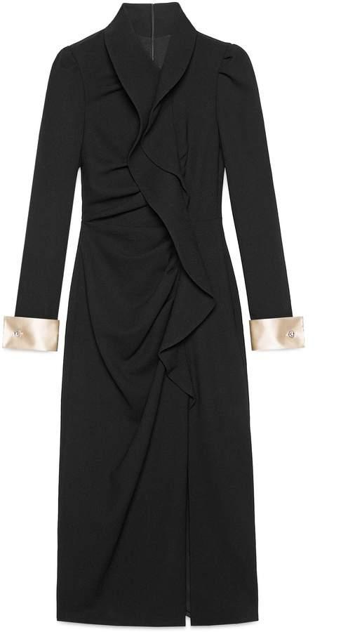 Wool dress with asymmetric flounce