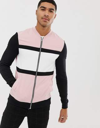 Asos DESIGN Muscle Jersey Bomber Jacket In Pink With Color Blocking