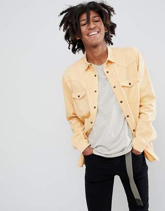Asos DESIGN oversized washed vintage look shirt in yellow