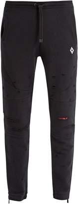 Marcelo Burlon County of Milan Distressed cotton-blend track pants