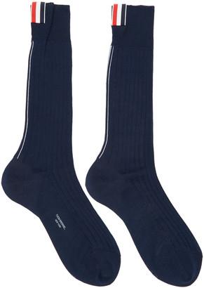 Thom Browne Navy Striped Socks $125 thestylecure.com