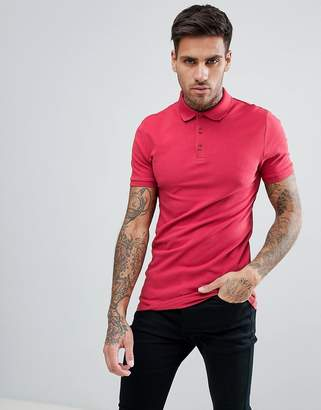 Asos DESIGN muscle fit polo in pique