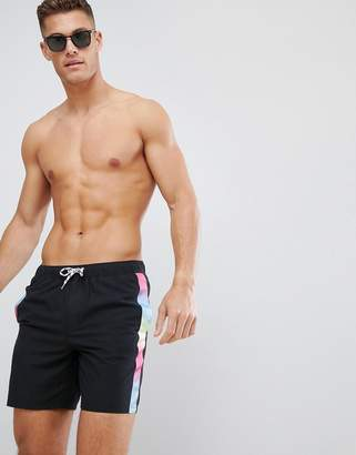 Asos DESIGN swim shorts with rainbow side tape in mid length