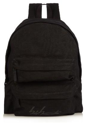 YOHJI YAMAMOTO Logo-printed linen backpack $961 thestylecure.com
