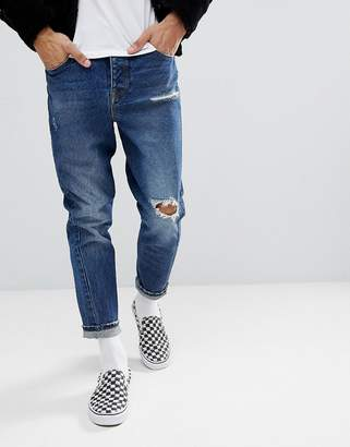 Asos DESIGN Twisted Seam Tapered Jeans In Dark Wash Vintage With Rips