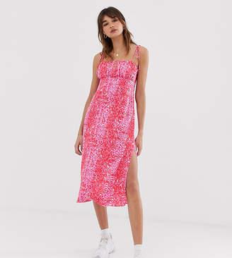 5cd44718ba28 Reclaimed Vintage inspired cami midi dress in animal print
