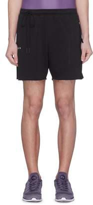 SIKI IM CROSS Reflective stripe raw cuff sweat shorts