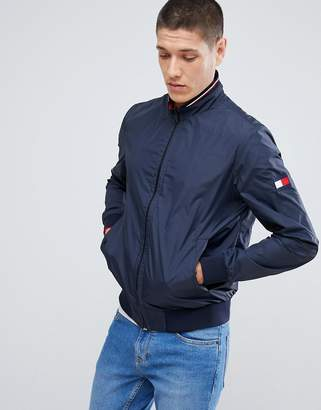 Tommy Hilfiger reversible lightweight bomber jacket sleeve & chest flag logo in navy/red