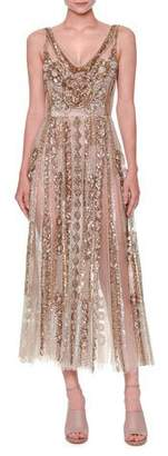 Valentino Sleeveless Sequined Tulle Gown, Nude/Gold $13,900 thestylecure.com