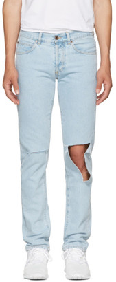 Off-White Blue Diagonal Raw Cut Slim Jeans $560 thestylecure.com