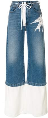 Off-White bird motif jeans