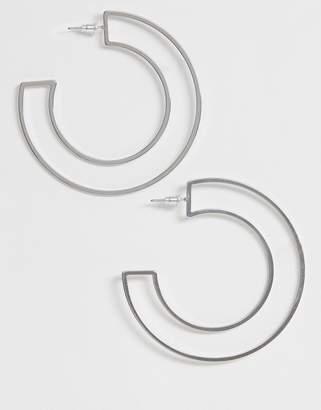 Asos Design DESIGN hoop earrings in cut out design in silver tone