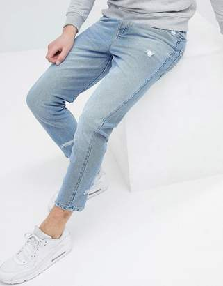 Asos DESIGN Skinny Twisted Seam Jeans In Light Wash Blue With Abrasions