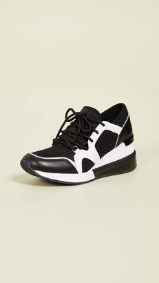 1657b8267147 MICHAEL Michael Kors Black Women s Sneakers - ShopStyle