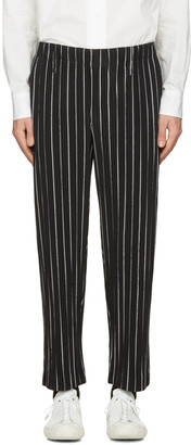 Homme Plissé Issey Miyake Black Striped Trousers $470 thestylecure.com