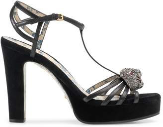 d5c1e976be26 Gucci Leather t-strap sandal with crystal feline head