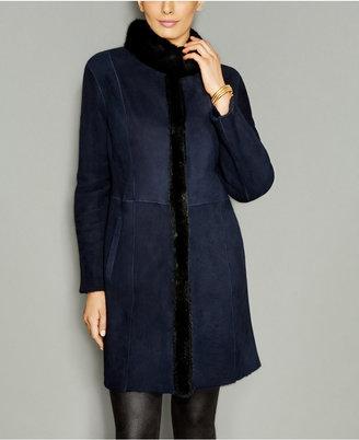 The Fur Vault Mink-Fur-Trim Shearling Lamb Coat $2,995 thestylecure.com
