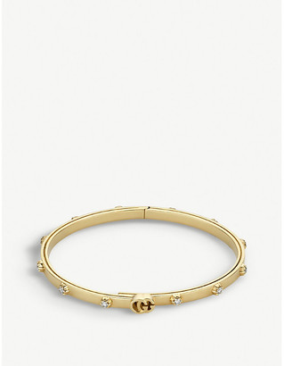 f1bb4f6bd7561a Gucci GG Running 18ct yellow-gold and white diamond bracelet