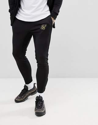 SikSilk skinny joggers in black with gold logo