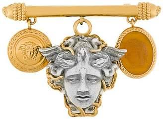 Versace medusa brooch