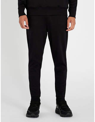 HUGO Logo-print tapered cotton-jersey trousers