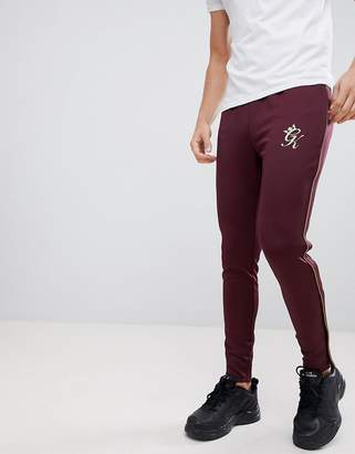 Gym King skinny joggers in burgundy with gold piping