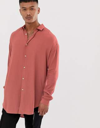 Asos Design DESIGN oversized pink crepe shirt with drop shoulder in longline