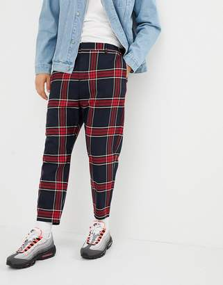 Bershka carrot fit check pants in black and red
