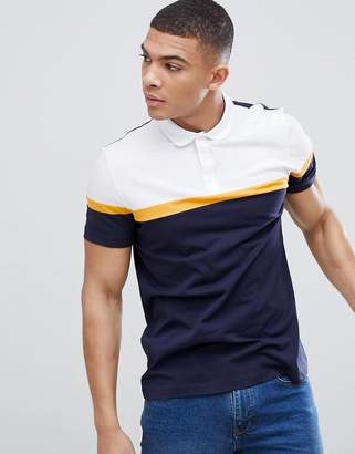 Asos DESIGN polo shirt with cut and sew panels in navy