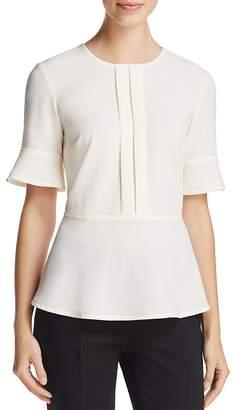 DKNY Bell Sleeve Peplum Top $129 thestylecure.com