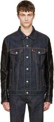 Junya Watanabe Indigo Faux-Leather Sleeves Denim Jacket $1,055 thestylecure.com