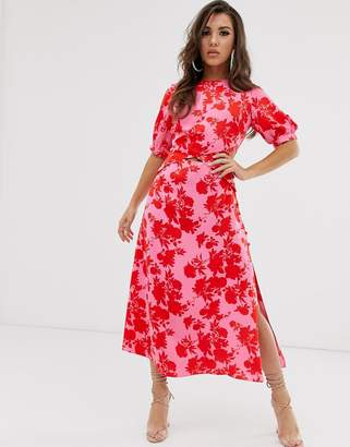 Asos Design DESIGN puff sleeve wrap front midi dress with cutout in floral print