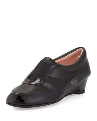 Taryn Rose Pooms Traveler Patent-Trim Wedge Sneaker, Black $229 thestylecure.com