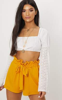 c81148abfd at PrettyLittleThing · PrettyLittleThing Mustard Crepe Ruched Tie Waist  Shorts